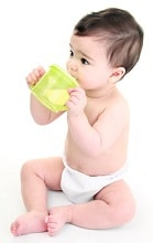 Baby drinking from cup